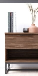 Closeup of brown, 1-drawer dresser holding books and vases