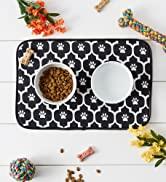 Black lattice food mat with small pet bowls on it