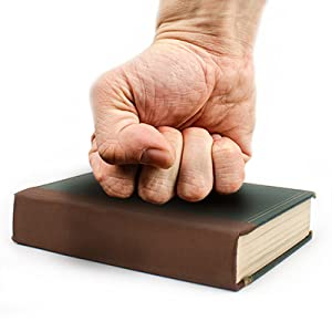 Book repaired with cloth BookGuard tape, with strong durable bookguard fist on top