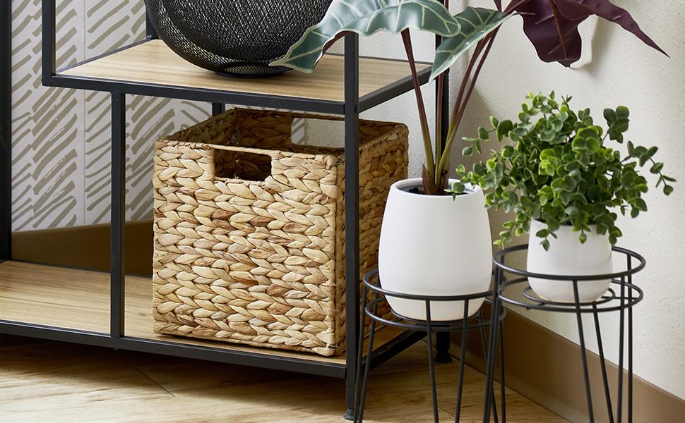 Closeup of black shelving, wood shelves, natural bin, black plant stands with plants