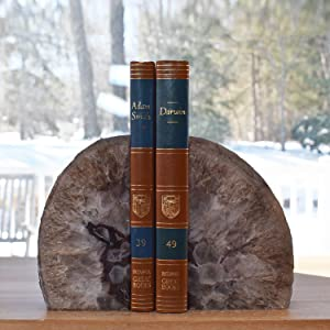 Black bookends with two books between them