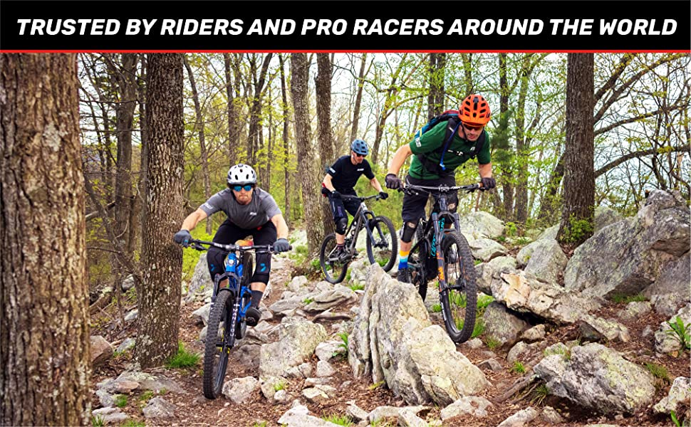 """A man riding a bike in the woods. Text reads: """"Trusted by riders and pro racers around the world."""""""