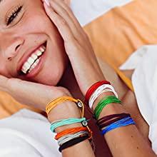 girl smiling wearing bracelets