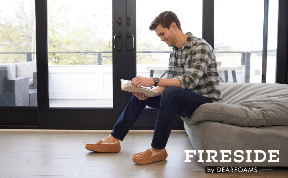 Man reading a book wearing melbourne moccasins while reading book