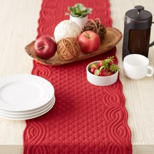 DII Quilted Farmhouse Tabletop Collection - Cranberry Table Runner used to set the dining table.
