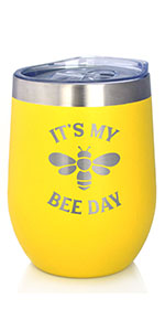 Text says Its my bee day, with design of a honey bee engraved onto a yellow tumbler