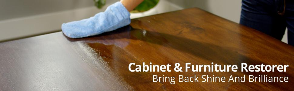 Woman's Hand in a microfiber mitt wiping a table with Rejuvenate Cabinet amp; Furniture Restorer