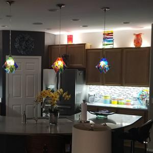 Above under kitchen cabinet light
