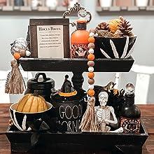 spooky season fall tiered tray with hocus pocus sign skeleton decor and pumpkins mug