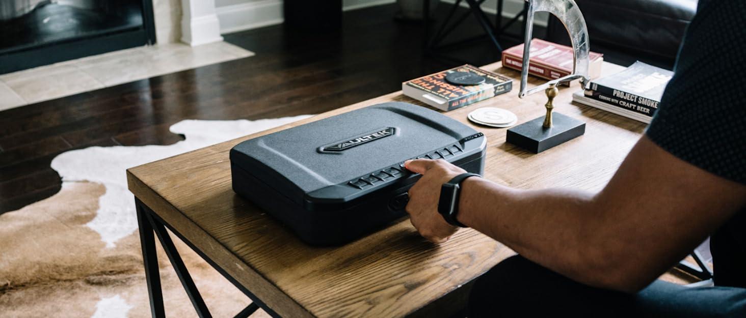 Individual scanning fingerprint their fingerprint on a Vaultek VT Series safe.