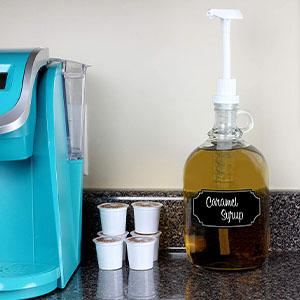 lifestyle in use pump jug dispenser caramel syrup sitting on counter