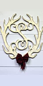 An Unfinished Wood Co Antler Monogram S painted White and distressed