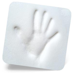 Hand imprint on white memory foam of wedge pillow