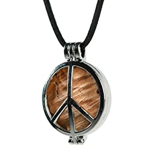Made from a Piece of the Original Woodstock Stage. Encased Inside a Silver Peace Pendant
