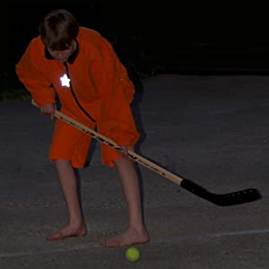 Hang safety reflector on kids playing outside in the dark