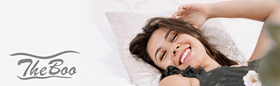 A smiling woman lying on a pillow and TheBoo logo on the right side of the image
