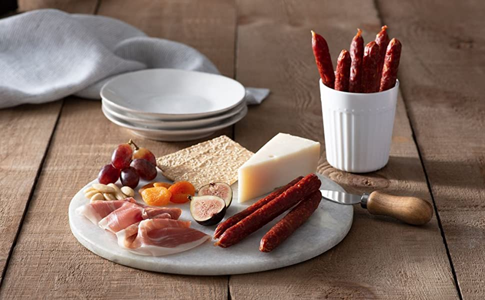 Platter with fruit, dried meat and cheese