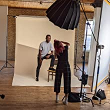 Female photographer shooting a male fashion model on Savage Seamless Paper