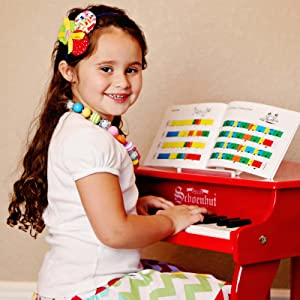 Little girl playing the schoenhut piano for kids
