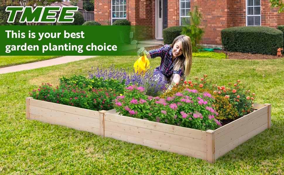 A beautiful woman is taking care of her planter boxes