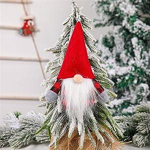 A dwarf Christmas doll hanging on the Christmas tree