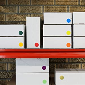 boxes on shelf with color coding dots, inventory, packing, shipping