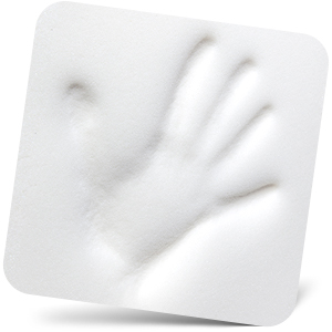 Hand indentation in white memory foam of mouse pad with wrist support