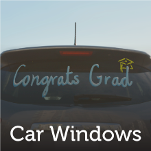 """Car with text on the window that says """"Congrats Grad""""."""