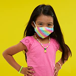 Little girl wearing colorful face mask