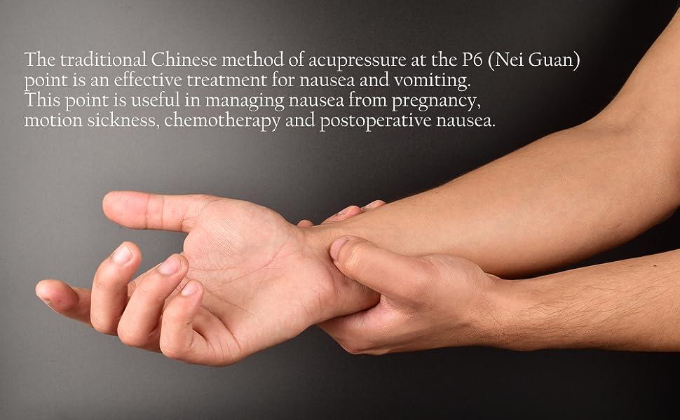 acupressure, hand doing self treatment at P6 Nei Guan, acupressure on black background