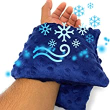 Microwavable Heating pad for Neck and Shoulders- Blue on top of a hand with snowflake