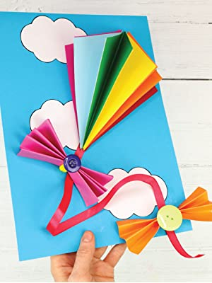 3D paper kite on a blue sky background with clouds.