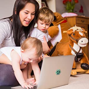 Mom playing with her kids and using a laptop with our EMF sticker