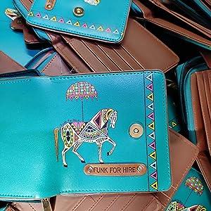 Pile of Horse printed loop wallets