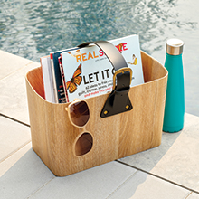 Natural Wood Grain Paperboard Storage Tote Caddy with Leather Handle Holding Magazines Next to Pool