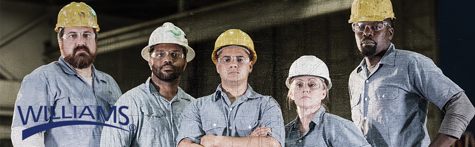 5 technicians standing in a row dressed for work in hard hats and safety glasses