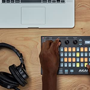 one hand on the akai pro fire.