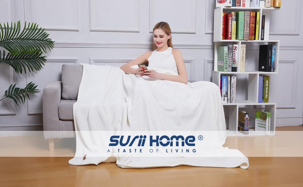 white blanket sofa scene