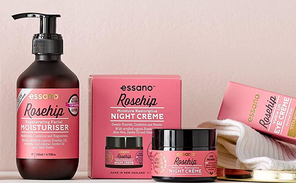 a few rosehip essano products in front of a blank wall