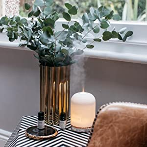 Neom Wellbeing Pod Diffuser and Essential oils