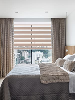 The combination of zebra blinds and fabric curtains accentuates the full aristocratic atmosphere