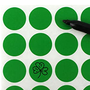 Green dots with clover drawn on using permanent marker