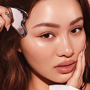 Sarah Cheung close up with Gua Sha