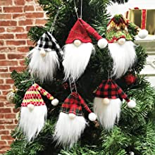 6 cute different dwarf Santas hanging on the Christmas tree