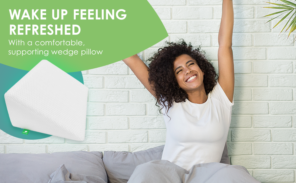 Woman waking up happy using the wedge pillow