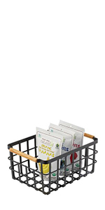 Black Metal Wire Kitchen Pantry Storage Basket with Wood Handles Containing Bags of Dry Snack Food