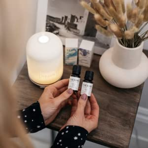 NEOM Perfect Night's Sleep wellbeing pod and essential oil