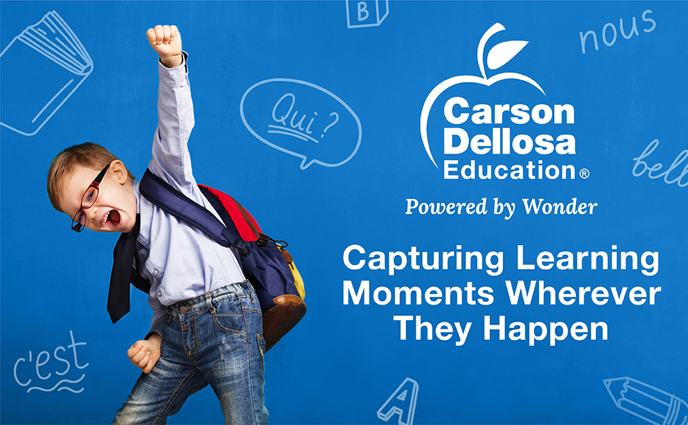 A boy raising his fist in the air in excitement. Capturing learning moments wherever they happen.