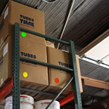 boxes in warehouse organized with large permanent color coding dots