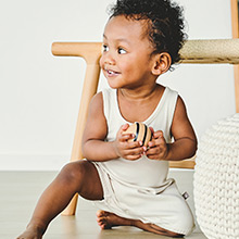 Adorable baby in soft organic romper.